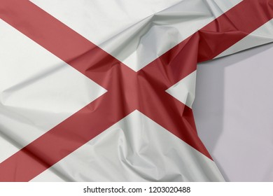 Alabama fabric flag crepe and crease with white space, The states of America,  Red St. Andrew's saltire in a field of white.