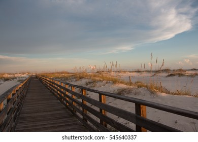 alabama gulf shores boardwalk to beach at sunset