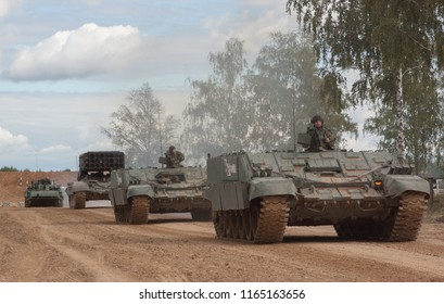 Alabino.Russian Federation - 08.25.2016:  Heavy Flamethrower System and two  armored fighting vehicle on dirt road