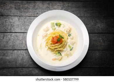 a-la-carte, seafood cream pasta on the table