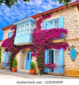 Alacati, Cesme / Turkey - June 21 2017 : Houses with colourful flowers
