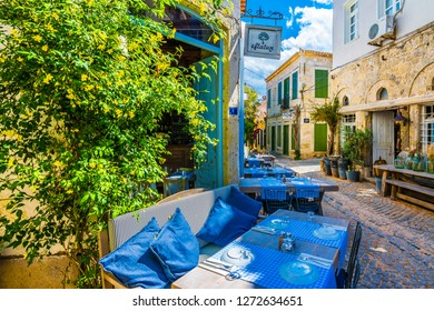 Alacati, Turkey - April 18, 2017 : Colorful streets HDR view in Alacati Village. Alacati is popular tourist destination in the Turkey.