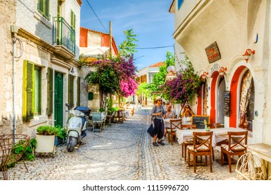 Alacati, Turkey - June 07, 2014 : Street view in Alacati, Turkey. Alacati, well known for its architecture, vineyards and windmills is a popular summer tourist destination.