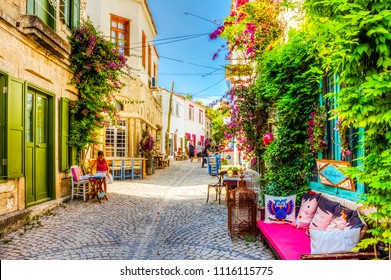 Alacati, Turkey - June 07, 2014 : Street view in Alacati, Turkey. Alacati, well known for its architecture, vineyards and windmills is a popular summer tourist destination,