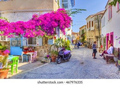 ALACATI, TURKEY - JUNE 07, 2014 : Street view in Alacati, Turkey. Alacati, well known for its architecture, vineyards and windmills is a popular summer tourist