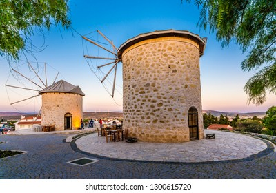 Alacati, Turkey - May 17, 2016 : People are visiting Windmills of Alacati Town in Izmir Province