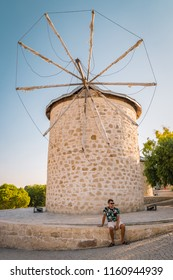 Alacati, Turkey street view in Alacati Town popular historical tourist destination in Turkey. man relaxing by old windmill