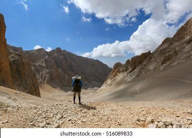 Aladaglar, TURKEY - September 12, 2016: Young guy  hiking around Aladaglar of Turkey Taurus mountains.