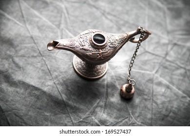 Aladdin Lamp on grey textile