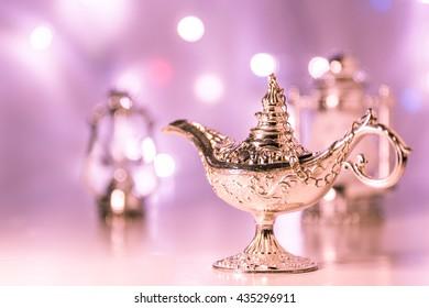 Aladdin's silver lamp in colorful light background. Ramadan concept backgrounda