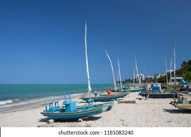 Maceió, Alagoas / Brazil - 09/10/2015: Artisanal fishing boats on Ponta Verde Beach