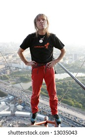 Alain Robert, French climber widely known as spiderman, climbed up one of the tallest buildings in Moscow and was briefly arrested after that on September 4, 2007.