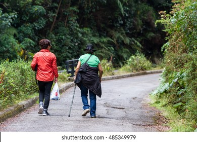 Alajuela, Costa Rica - May 02: Active older women hiking in the Poas Natural park. May 02 2016 Alajuela, Costa Rica.