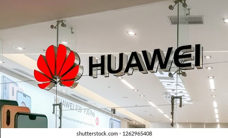 Alajuela, Costa Rica - October 04, 2018: Sign and logo of Huawei above the store entrance. Huawei is Chinese networking, telecommunications equipment, and services company.
