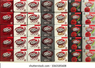 Alameda, CA - April 05, 2018: Cases of Dr Pepper soda stacked in rows. Dr Pepper was first nationally marketed in the United States in 1904, now exported and sold in many countries around the world.
