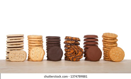 Alameda, CA - April 19, 2019: Stacks of popular Girl Scout cookies, Available annually during Girl Scout cookie sales, on a wood table with white background.