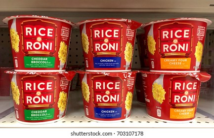 Alameda, CA - August 17, 2017: Grocery store shelf with cups of Rice a Roni brand instant rice. Cheddar Broccoli, Chicken flavor and Creamy Four Cheese. The San Francisco treat.