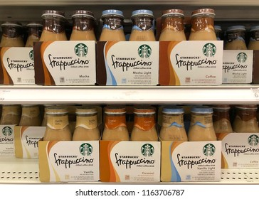 Alameda, CA - August 24, 2018: Grocery Store shelf with bottles of Starbucks brand frappuccino in various flavors. As of 2018, Starbucks operates 28,218 store locations worldwide.
