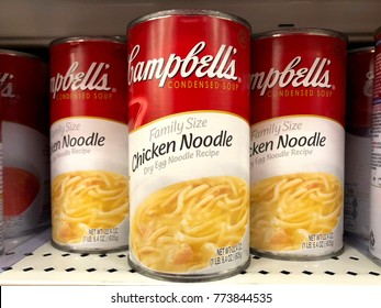 Alameda, CA - December 08, 2017: Grocery store shelf with cans of Campbell's brand Condensed Chicken Noodle Soup. Family Size cans. Campbell's products are sold in 120 countries around the world.
