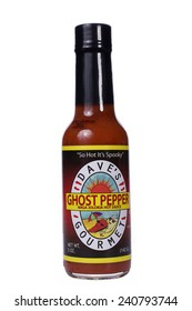 ALAMEDA, CA - DECEMBER 13, 2014: 5 ounce bottle of Dave's Gourmet brand Ghost Pepper Naga Jolokia Hot Sauce. So Hot It's Spooky.