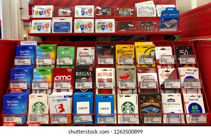 Alameda, CA - December 20, 2018: Variety of gift cards displayed at a grocery store. Gift cards give the recipient the freedom to purchase whatever they'd like, up to a certain price.