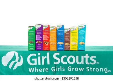 Alameda, CA - February 06, 2019: Traditional Girl Scout cookie booth table with Little Brownie Baker brand cookies isolated on white. Cookie sales raise funds for troop lead events and activities.