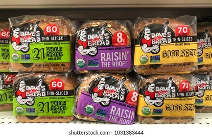 Alameda, CA - February 17, 2018: Grocery store shelf with bags of Dave's Killer Bread. Dave's Killer Bread is an American company based in Milwaukie, Oregon, which makes organic whole-grain breads.