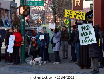 Alameda, CA - Jan 9, 2020: Unidentified Alameda residents protesting the concept of war with Iran.