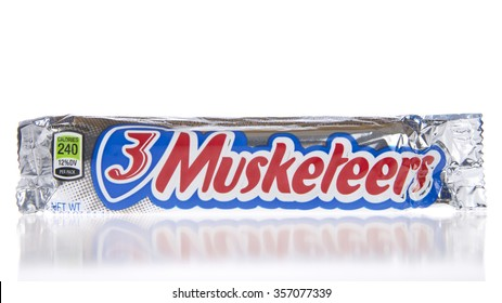 ALAMEDA, CA - JANUARY 01, 2016: One 3 Musketeers bar on a reflective white surface. 3 Musketeers was the third brand produced and manufactured by M&M Mars company, introduced in 1932.