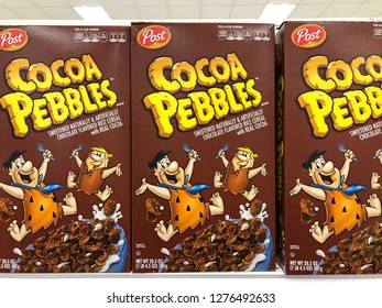 Alameda, CA - January 03, 2018: Grocery store shelf with Family size boxes of Post brand Cocoa Pebbles cereal.
