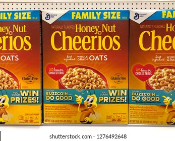 Alameda, CA - January 03, 2018: Grocery store shelf with Family Size boxes of General Mills brand Honey Nuts Cheerios cereal.