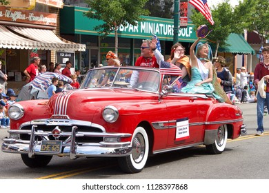 Alameda, CA - July 04, 2018: The Alameda 4th of July Parade is one of the largest and longest Independence Day parade in the nation. Poet Laureates Cathy Dana and Gene Kahane waving to the crowd.