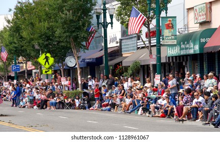 Alameda, CA - July 04, 2018: The Alameda 4th of July Parade is one of the largest and longest Independence Day parade in the nation. Hundreds of spectators line the streets to watch the parade.