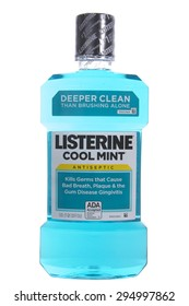 ALAMEDA, CA - JULY 08, 2015: One liter bottle of Listerine brand Mouthwash. Cool mint. Kills Germs that Cause Bad Breath, Plague and the gum disease Gingivitis. ADA accepted.