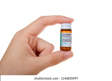 Alameda, CA - July 23, 2018: Hand holding small bottle of nitroglycerin sublingual tablets, qty 25. Bottle good until expiration date or for 6 months after opening. Smaller bottle cuts down on waste.