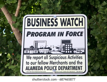 Alameda, CA - July 30, 2017: Close up on sign for the local business watch, similar to a neighborhood watch but for shops and store owners in the small island town of Alameda