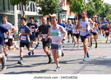 Alameda, CA - July 4, 2019: Unidentified participants in the Alameda Mayor's 4th of July R.A.C.E. A five km run and walk through Alameda, benefits to the Midway Shelter for Women and Children.