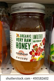 Alameda, CA - July 5, 2016: One bottle of Madhava brand Organic Very Raw Honey for sale on grocery store shelf. Imported from Brazil. Certified USDA Organic.