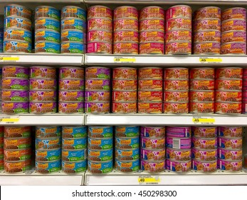 Alameda, CA - June 15, 2016: Many cans and flavors of Friskies brand cat food on grocery store shelf. Friskies is owned by Nestle Purina PetCare Company, a subsidiary of Nestle.