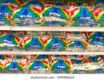 Alameda, CA - June 28, 2021: Grocery store shelves with dozens of bags of Jet Puffed brand marshmallows. Popular summer treat and ingredient in S'Mores.