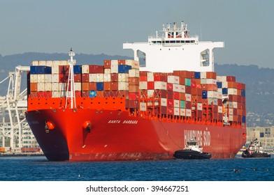 "Alameda, CA - March 9, 2015: Oakland Oakland Container Shipyard, San Francisco Bay, the Hamburg Sud ship ""Santa Barbara"" maeuvering into dock"