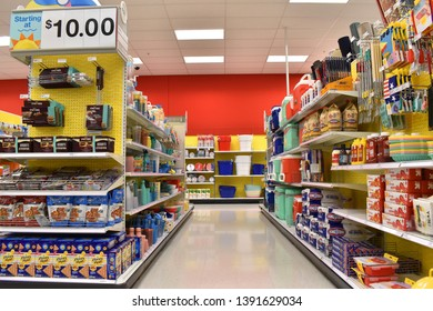 Alameda, CA - May 07, 2019: Convenience store aisle with summer toys and supplies, end cap with graham crackers, marshmallows and chocolate, supplies for s'mores, a popular summer treat.
