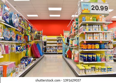 Alameda, CA - May 07, 2019: Convenience store aisle with summer toys and supplies, end cap with various brands of sun screens.