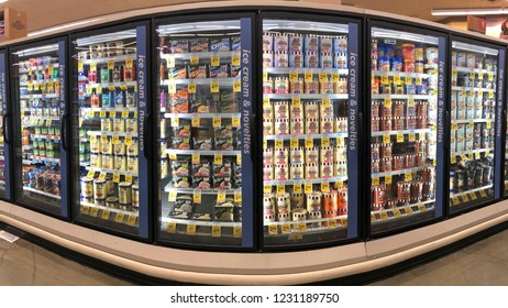 Alameda, CA - November 15, 2018: Grocery store shelf refrigerator freezer isle with containers of various brands and varieties of ice creams.