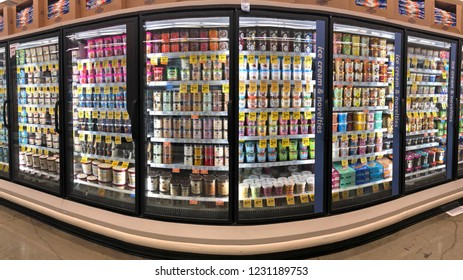 Alameda, CA - November 15, 2018: Grocery store shelf refrigerator freezer isle with containers of various brands and varieties of ice creams, sherberts, sorbets and gelato.