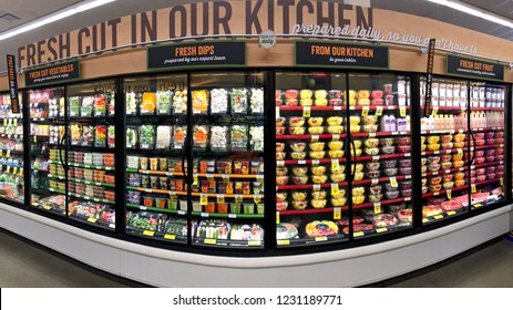 Alameda, CA - November 15, 2018: Grocery store shelf refrigerator isle with fresh prepared fruits, vegetables and dips. Sliced and ready to serve.