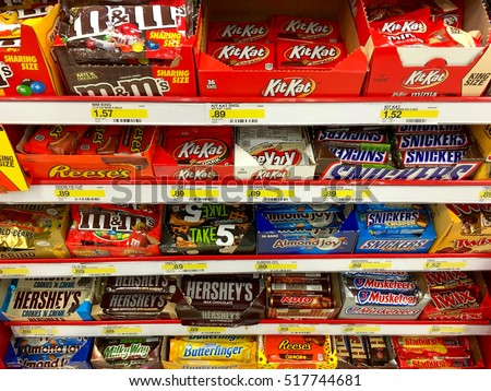 Alameda, CA - November 17, 2016: Many candy bars in a display in the check out line at the grocery store, placed in a highly visible place where you will see it to potentiate impulse purchases.