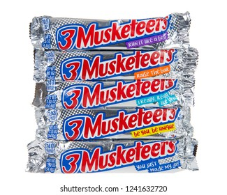 Alameda, CA - November 21, 2018: 3 Musketeers bars with inspirational messages isolated on white. The 3 Musketeers Bar was the third brand produced and manufactured by M and M/Mars, introduced in 1932