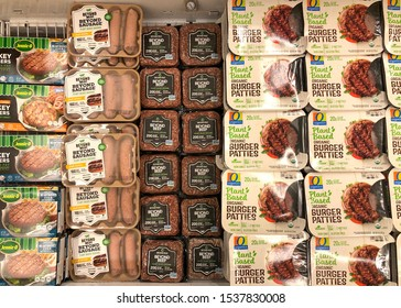 Alameda, CA - Oct 18, 2019: Grocery store refrigerator section with rows of various brands of plant based protein substitutes. Plant based proteins can be as healthy as animal based proteins.