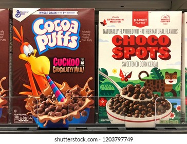 Alameda, CA - October 01, 2018: Grocery store shelf with Boxes of General Mills brand Cocoa Puffs next to generic brand Choco Spots.